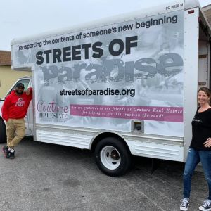 Streets of Paradise celebrates moving 100 people into homes